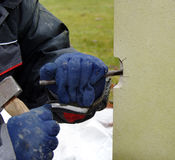 Stone Mason. Repairing Stonework with a hammer and Chisel Royalty Free Stock Photography