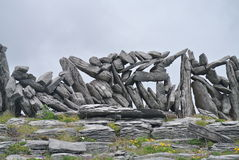 Stone mason. Inis Mor Aran Island, Ireland A path along the rocky shore on the way to Worm Hole stock photography