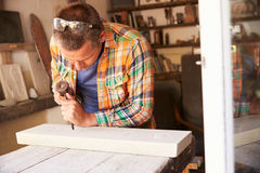 Stone Mason At Work On Carving In Studio Royalty Free Stock Image