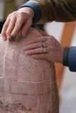 Stone mason working Stock Images