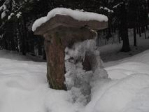 The stone masoned drinking fountain. Covered with snow and ice,The Durmitor National Park Stock Photos