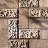 Stone masonry. Masonry of cinder block with decorative elements, grunge background Stock Photos