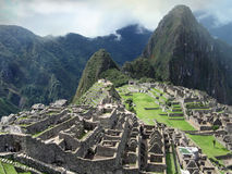 Stone masonry architecture of Machu Picchu. Peru. Structure architecture of temple complex Machu Picchu: guard houses, agriculture terraces and surrounding Royalty Free Stock Photography