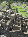Stone masonry of Machu Picchu. Peru. Structure architecture of temple complex Machu Picchu: guard houses, agriculture terraces and surrounding mountains in the Royalty Free Stock Image