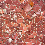 Stone masonry wall as background, stone  texture. Red shade of aging Royalty Free Stock Image