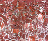 Stone masonry wall as background, stone  texture. Red shade of aging Royalty Free Stock Photography