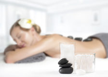 Stone massage. Beautiful woman getting hot stones massage in spa. Beauty treatments. Woman getting hot stone massage at spa salon Royalty Free Stock Photos