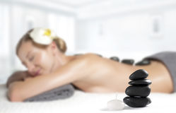 Stone massage. Beautiful woman getting hot stones massage in spa. Beauty treatments. Woman getting hot stone massage at spa salon Royalty Free Stock Image