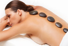 Stone Massage. Beautiful Woman Getting Spa Hot Stones Massage. S Stock Photography
