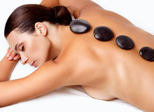 Stone Massage. Beautiful Woman Getting Spa Hot Stones Massage. In Spa Salon Stock Photo