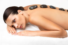 Stone Massage. Beautiful Woman Getting Spa Hot Stones Massage in Royalty Free Stock Photos