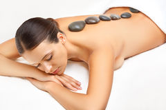 Stone Massage. Beautiful Woman Getting Spa Hot Stones Massage Royalty Free Stock Image