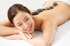 Stone Massage. Beautiful Woman Getting Spa Hot Stones Massage Royalty Free Stock Photography