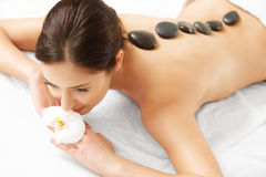 Stone Massage. Beautiful Woman Getting Spa Hot Stones Massage Royalty Free Stock Images