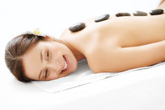 Stone Massage. Beautiful Woman Getting Spa Hot Stones Massage in Spa Salon. Stock Photo