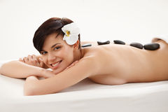 Stone Massage. Beautiful Woman Getting Spa Treatme Stock Photos