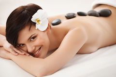 Stone Massage. Beautiful Woman Getting Spa Treatment Royalty Free Stock Images