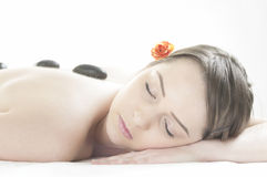 Stone massage in the day spa Stock Photos