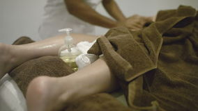 Stone massage of female legs at beauty spa stock video footage