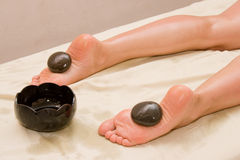 Stone massage in spa Stock Photo