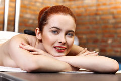 Stone massage, woman getting a hot stone massage. At spa salon Royalty Free Stock Image