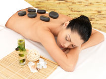 Stone massage for woman at  spa salon. Stock Images