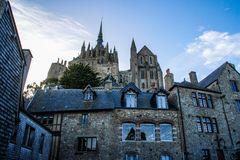 Stone medieval houses and a cathedral in the city of Seint Michel Abbey stock photos