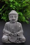Stone meditating Buddha statue Stock Image