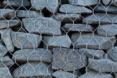 Stone and mesh fencing. Reinforcement and design of stone and mesh exterior royalty free stock image