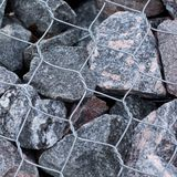 Stone and mesh fencing. Reinforcement and design of stone and mesh exterior royalty free stock photos