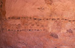 Stone message at the Manitou Cave Dwellings. Manitou Springs, CO/USA - Circa September 2016: Inlaid stones in a wall at the Manitou Cliff Dwellings in Manitou Stock Photo