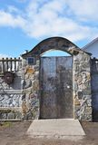Stone and Metal Fence with Door of Style Design Decorative Cracked Real Stone Wall royalty free stock photography