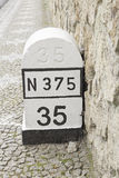 Stone mileage. In urban road sign Stock Images