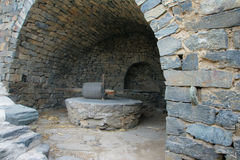 Stone mill. In stone brick room.  is traditional milling tool in Chinese village Stock Image