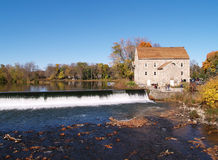 Stone mill by waterfall royalty free stock image