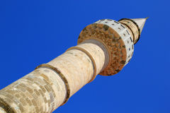 Stone minaret of ancient mosque on Greek Island of Kos. Intricately carved ancient stone carved minaret tower of mosque on Kos Island in Greece stock photography
