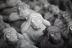 Stone miniature figurines of monkeys Royalty Free Stock Images