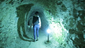 Stone mining tunnel young woman tourist stock video