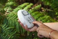 Stone mobile phone Stock Photo