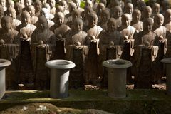 Stone monks statues Stock Images