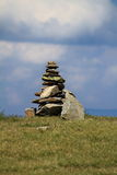 Stone monument. Pile of rocks on a mountain top Stock Photo