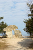 The stone monument standing at the seashore in Latvia Stock Photos