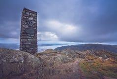 Stone monument on the summit of Mount Ulriken Stock Photo