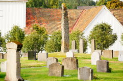Stone monuments and memorials , Norway. Norwegian cemetery with olden metalic cross in Kragero kommune Telemark, Norway.  Autumn in Norway. Stone monuments and Royalty Free Stock Image
