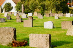 Stone monuments and memorials , Norway. Norwegian cemetery with olden metalic cross in Kragero kommune Telemark, Norway.  Autumn in Norway. Stone monuments and Stock Photography