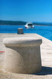 Stone mooring bollard. Travel concept Royalty Free Stock Photo