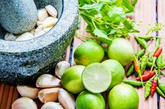 Stone mortar with ingredients food Royalty Free Stock Photography