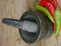 Stone Mortar and Pestle with Chili Stock Images