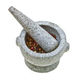 Stone mortar and pestle with crushed pepper Royalty Free Stock Photo