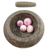 Stone Mortar And Pestle With Onions VI Royalty Free Stock Photos
